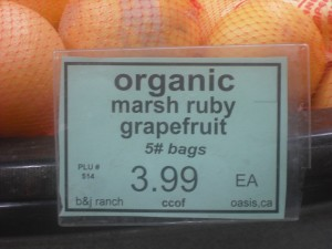 Rainbow Grocery labels the state or country of origin of all of its produce, and the town if it's from California. These grapefruit are from Oasis, a small town in Southern California.