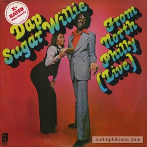 "Dap Sugar Willie, dissed by the Rolling Stone Record Guide as the ""least funny black comic alive,"" though they rather undermined their authority by misspelling his name as Dap Sugar Willy in their entry."