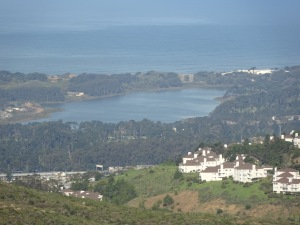 View of Lake Merced from the Summit Loop trail, with a hillside settlement on the right.