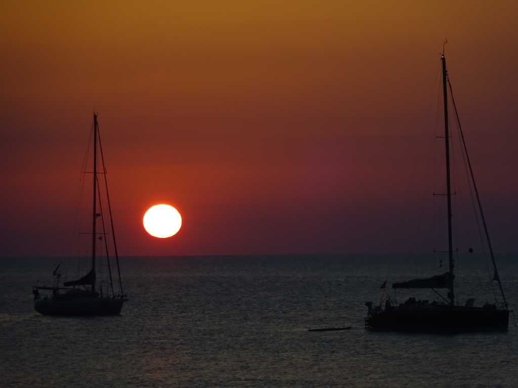 Sunset as viewed from the beach in Cefalu.
